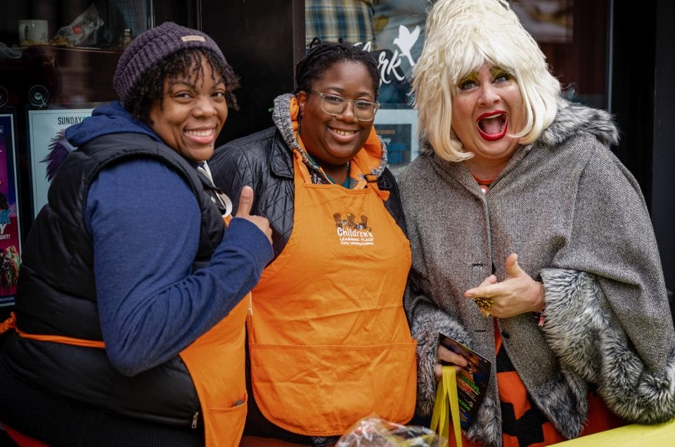 boystown chicago halloween trick or treating pup crawl - drag queen miss foozie at children's learning place table